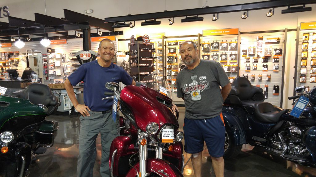 Mike (on the right) and I at the Harley Dealer