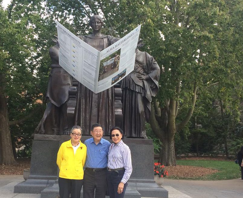 Professor Kuo in front of the Alma Mater Statue
